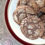 Molasses cookies on a white and red plate