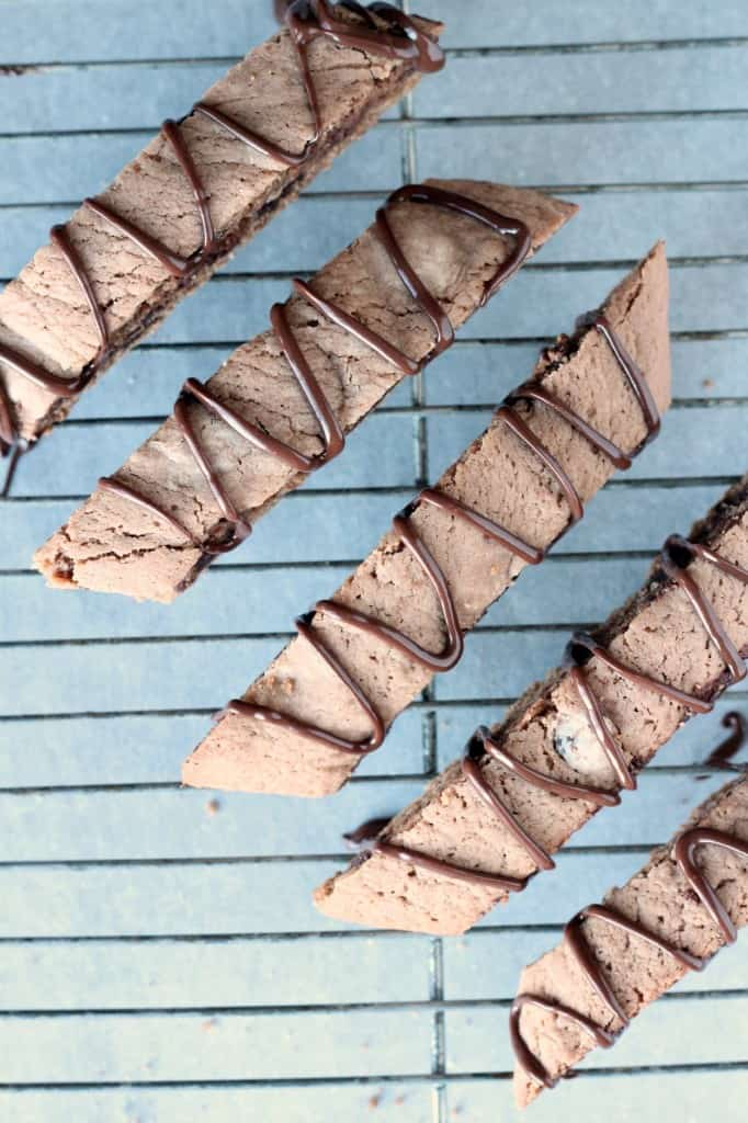 mocha biscotti drizzled with chocolate on wire rack