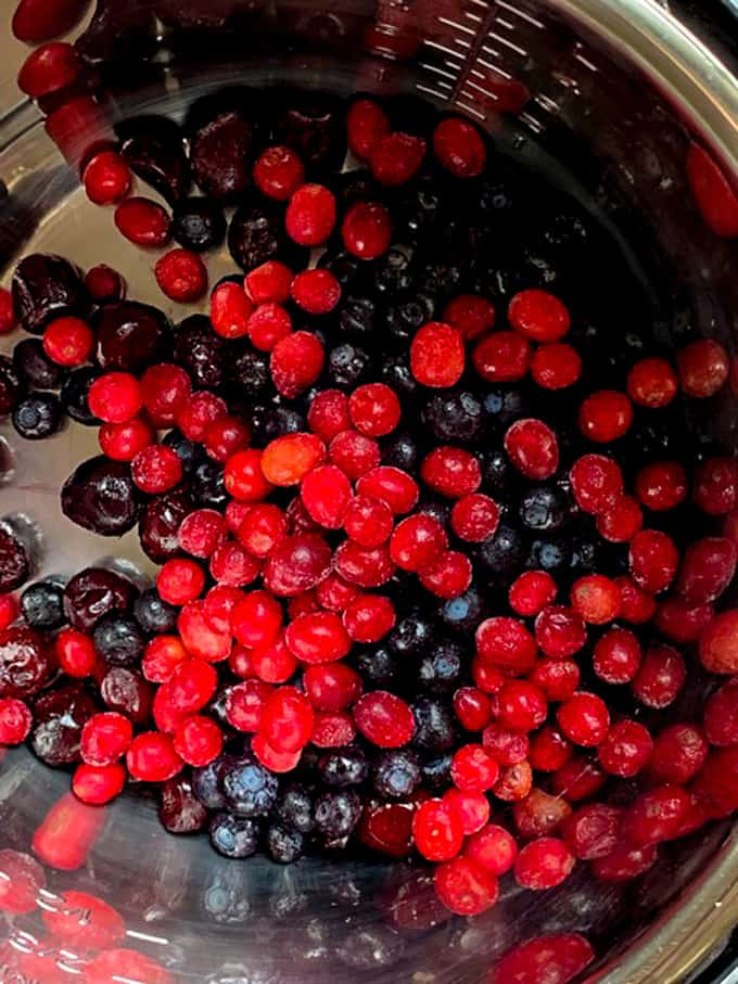 Frozen berries are in the Instant Pot for making wojapi