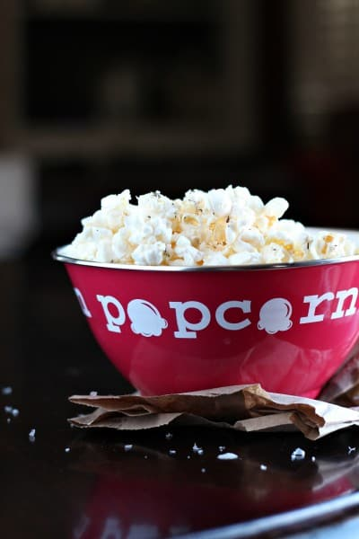 herbed popcorn in red bowl