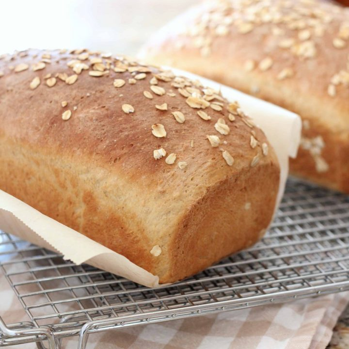 Maple Oatmeal loaves of bread on wire cooling rack
