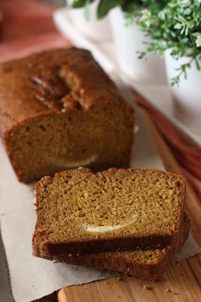 pumpkin-bread-with-cream-cheese sliced on white plate
