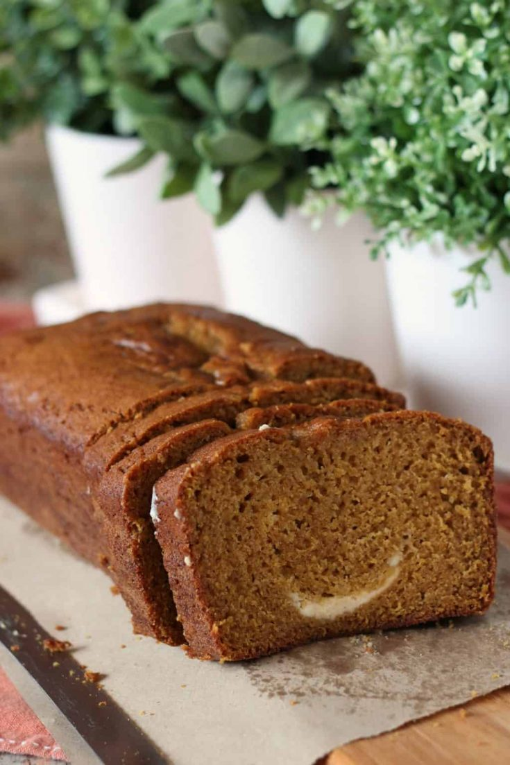Pumpkin Bread with Cream Cheese Swirl is your go-to quick bread for autumn baking. Easy to pull together and even easier to eat, this pumpkin bread is a seasonal favorite. #pumpkin #creamcheese #breadrecipe #quickbread #homemadebread