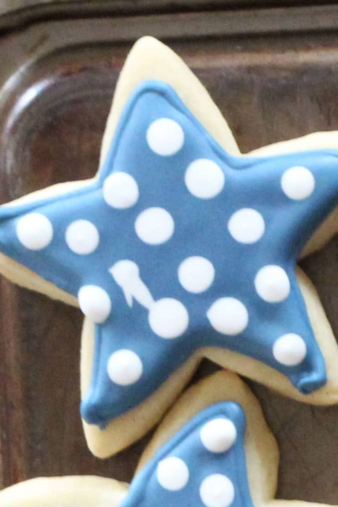 Star cookie cut out with blue and white royal icing