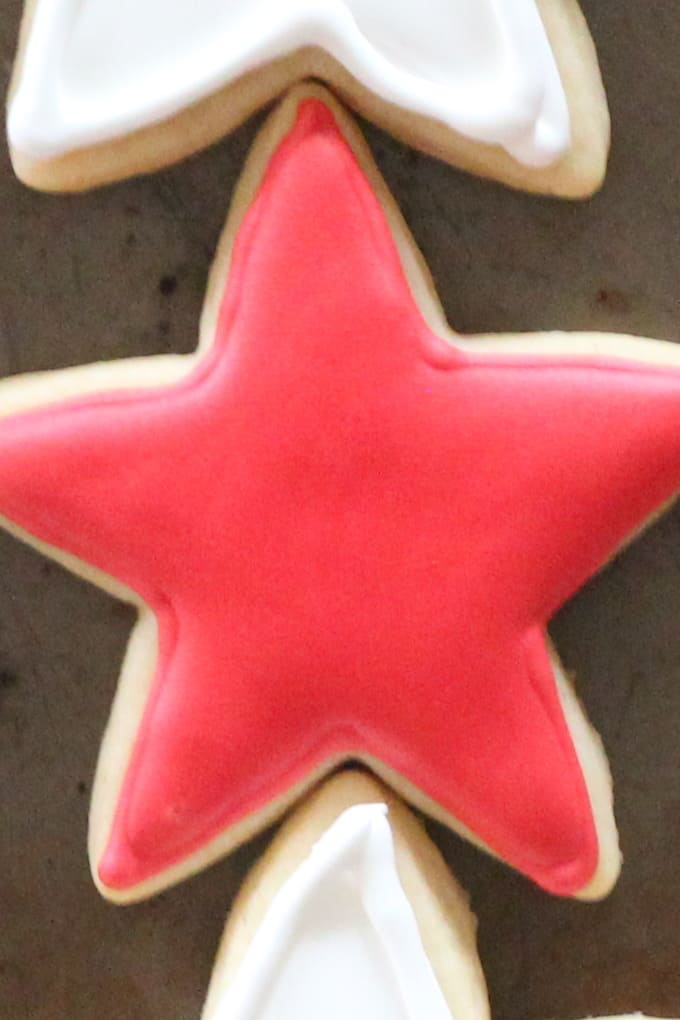 Star cut out cookies decorated with red royal icing