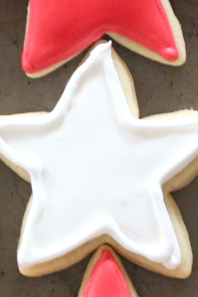 Cut out cookie in the shape of a star decorated with white royal icing