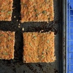 carrot flatbread on a baking pan with blue napkin