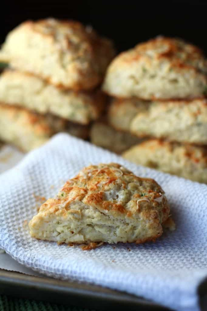 cheese scones with chives on a white towel