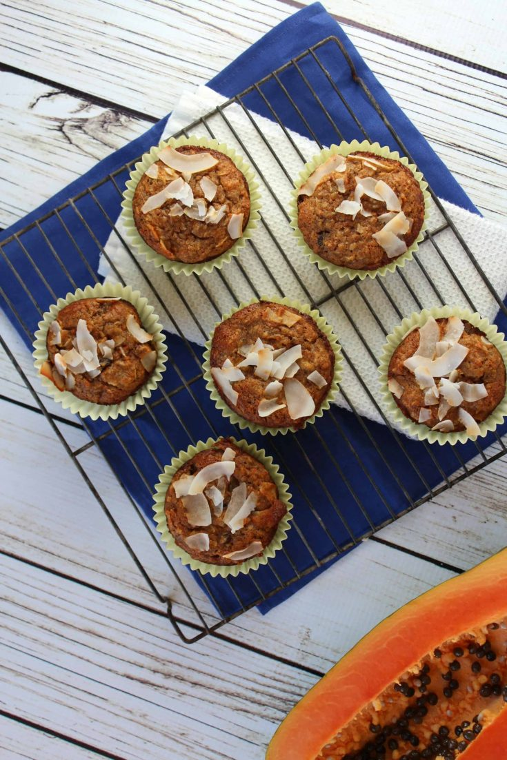 Papaya, bananas, dried pineapple, and coconut come together in this muffin to give you a tropical feeling to the start of your day. #abakershouse #sponsored #sprouts #muffinrecipe #coconutrecipe #bananamuffin
