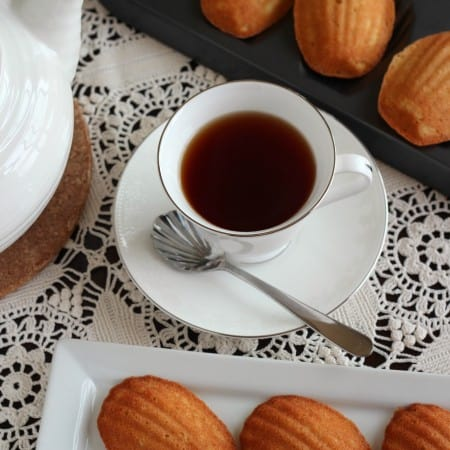 Honey vanilla madeleines on white lace tablecloth