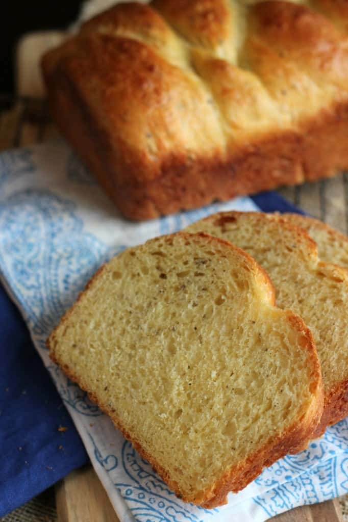 Italian Easter Cheese Bread with two slices in front and loaf of bread in background