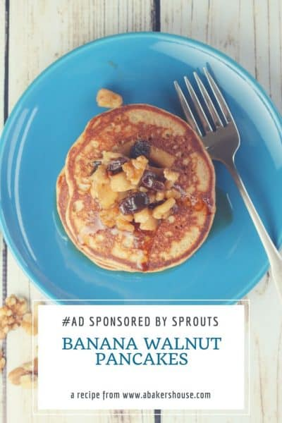 Stack of banana walnut pancakes on blue plate with silver fork