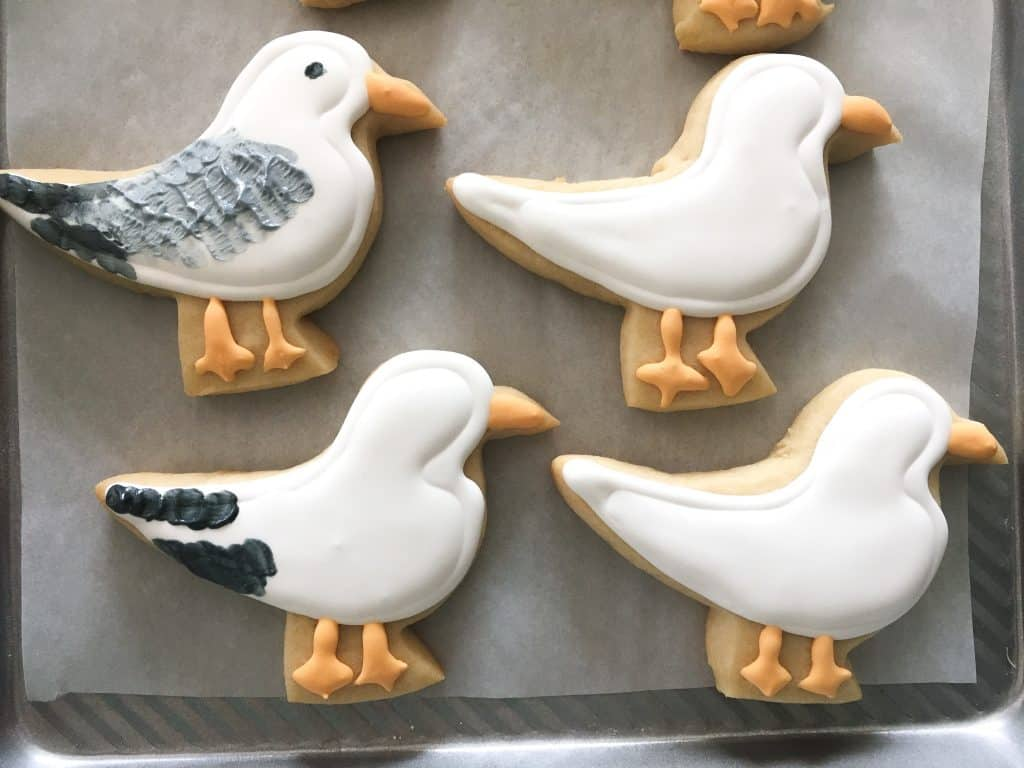 sugar cookie seagull cookies decorated in steps with royal icing