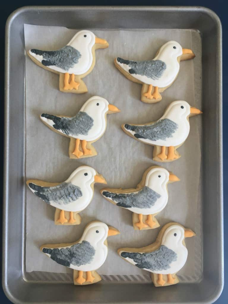 seagull cookies on parchment paper and cooking sheet