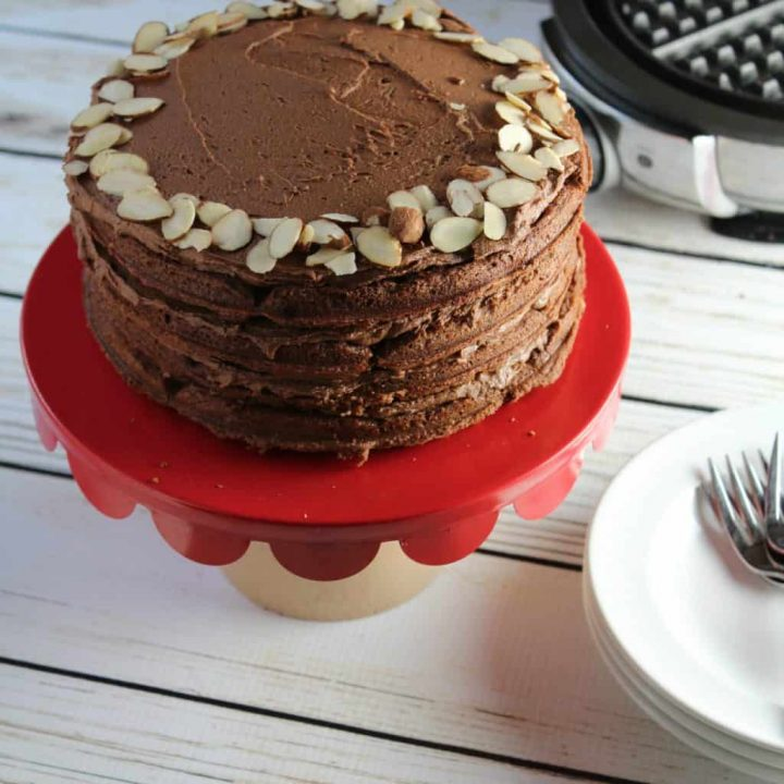 Gluten Free Chocolate layer cake made with waffles in each layer.