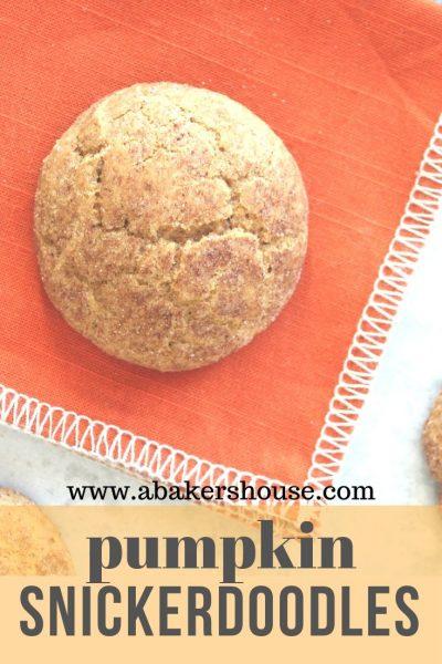 Pumpkin snickerdoodle cookei on an orange napkin
