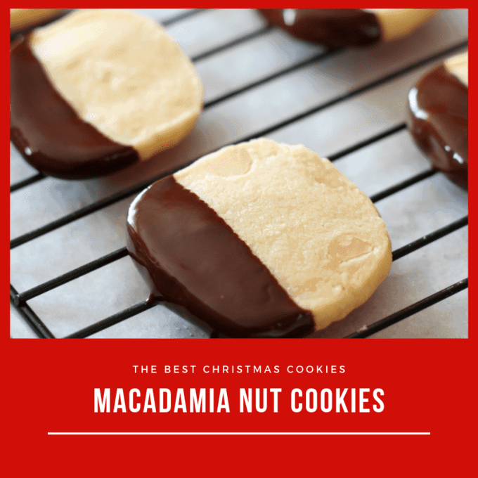 Chocolate dipped macadamia nut cookies on wire rack and parchment paper