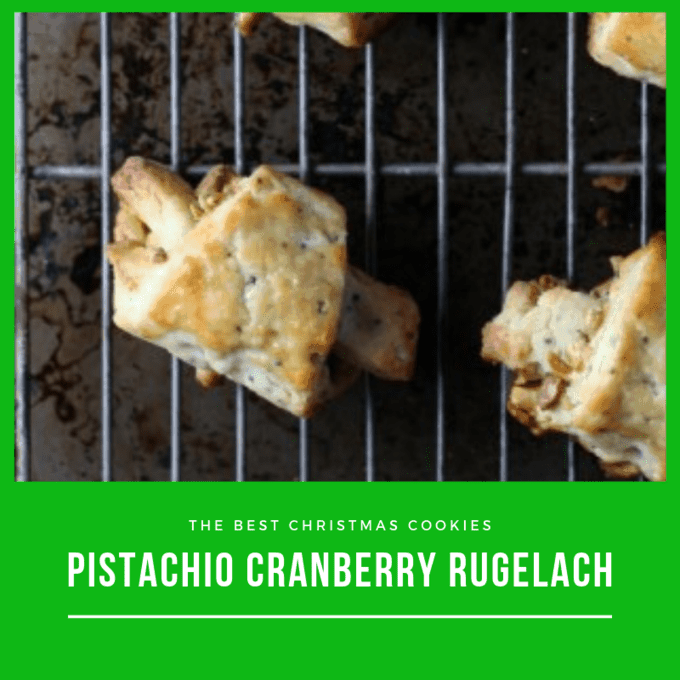 Pistachio Cranberry Ruglach cookies on a wire cooling rack on top of a baking sheet