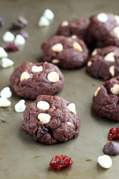 double chocolate cookies with dried cherries on a baking pan