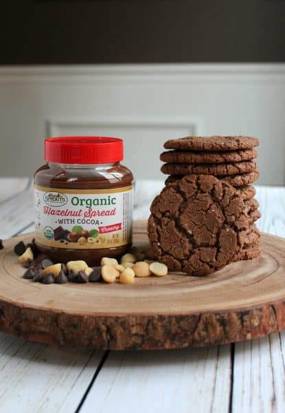 jar of hazelnut spread next to stack of chocolate cookies