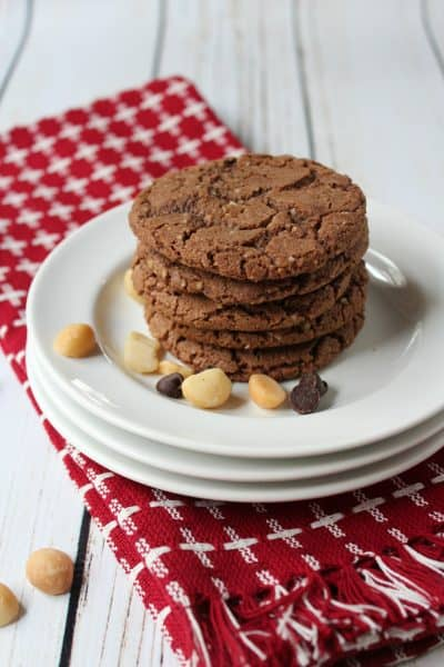 stack of chocolate cookies on red checkered napkin and white plate