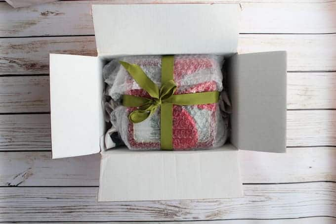 Bubble wrapped package in a rectangular shipping box