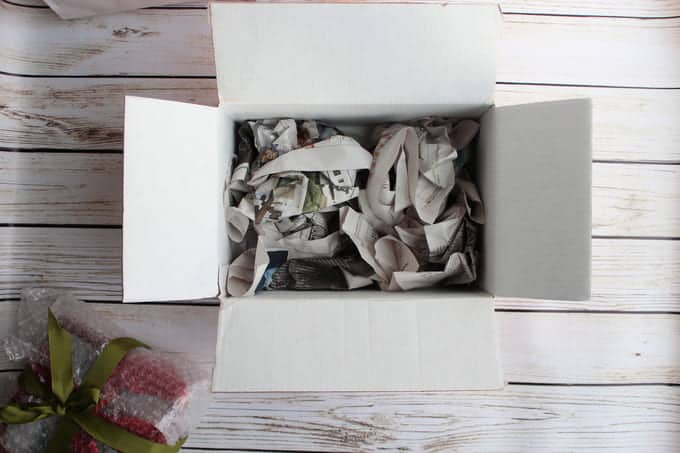 Newspaper crumpled in the bottom of a box
