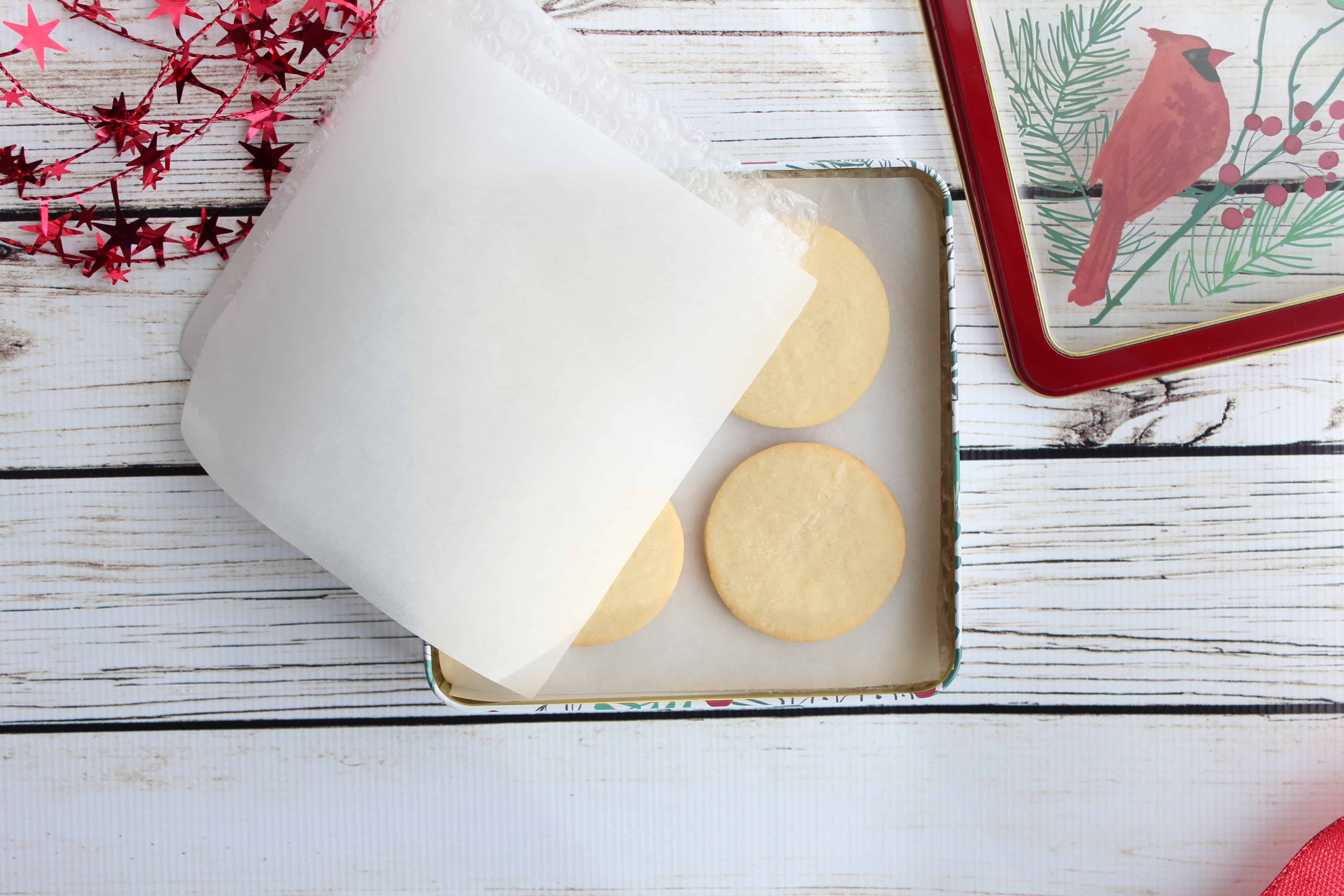 Circular cookies in a square tin with parchment paper