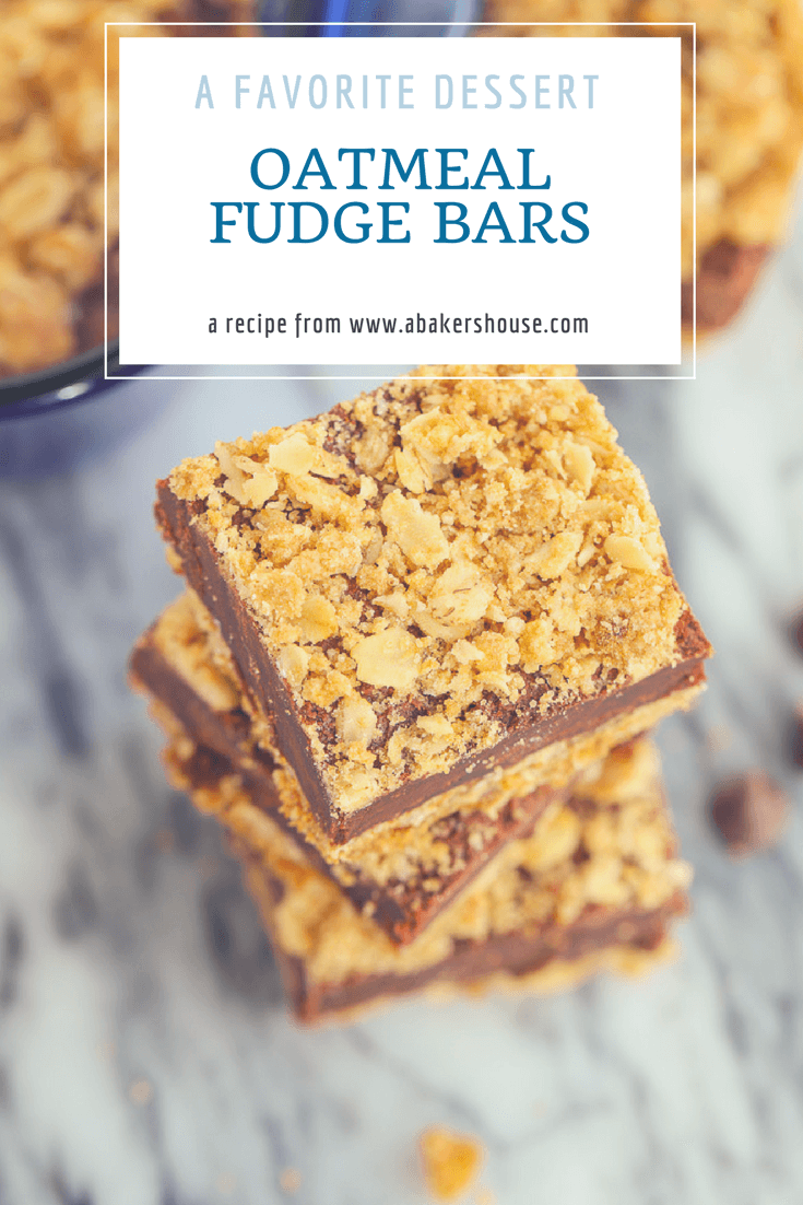 Oatmeal Fudge Bars may become your most requested dessert. A thick fudge-like layer of chocolate is sandwiched between a crunchy oatmeal base and a crumbled oatmeal topping. #oatmeal #fudge #dessertforacrowd #layeredbars #abakershouse #chocolate
