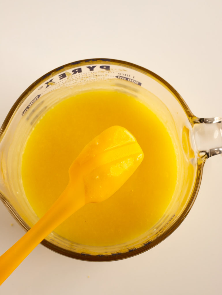 yellow spatula was dipped into bright yellow lemon curd