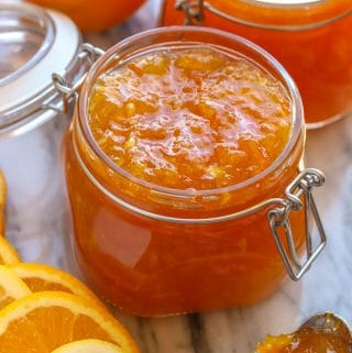 Jar filled with orange lemon marmalade