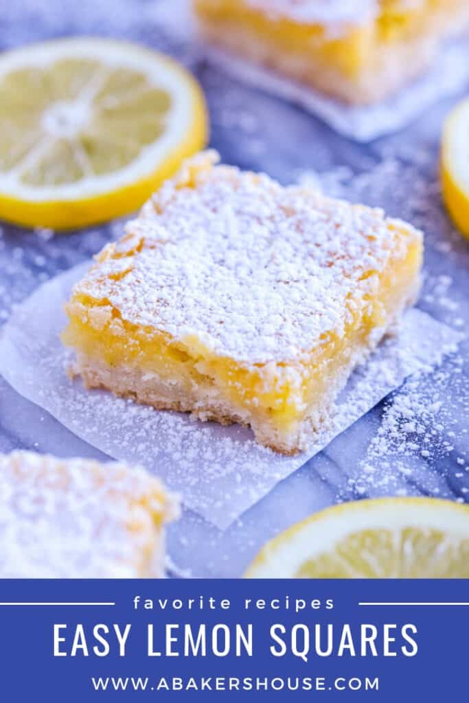 Lemon squares with lemon slices on marble board