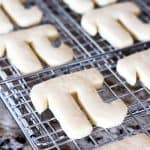 Pi sugar cookies on a wire rack