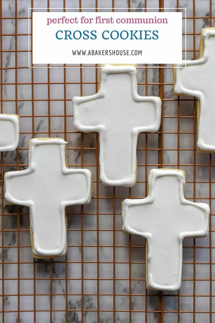 Simply decorated cross cookies are made from a cut out cookie recipe then decorated with white royal icing. These cross cookies are perfect for first communion favors, baptism desserts, or Easter treats.#firstcommunion #crosscookies #cutoutcookies #royalicing #baptism #christening #decoratedcookies