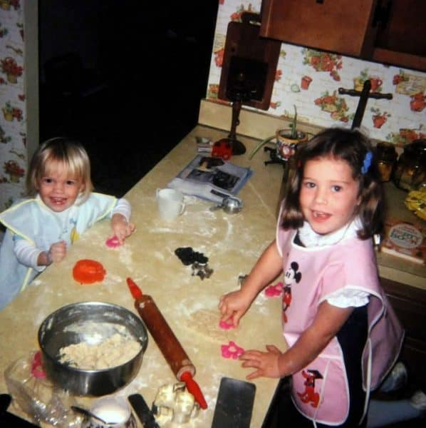 Young holly baker baking cookies with her sister