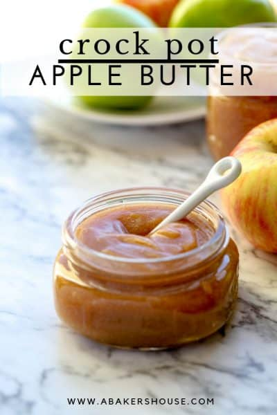 Mason jar filled with apple butter on a marble counter