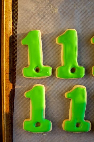 green background for hole in one golf cookies