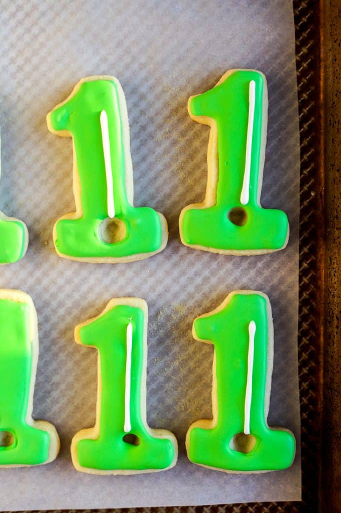 White golf pole on green cookies