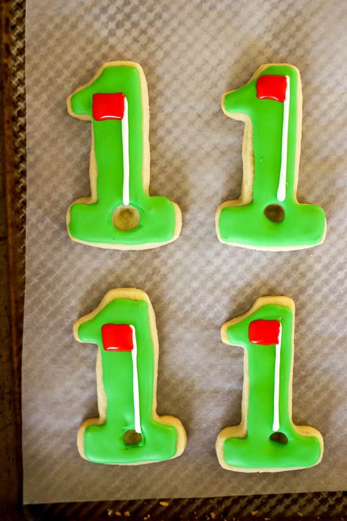 red golf flag on green hole in one cookies