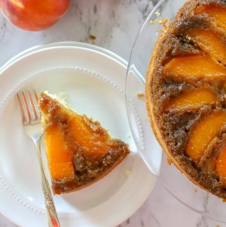overhead photo of slice of upside down peach cake
