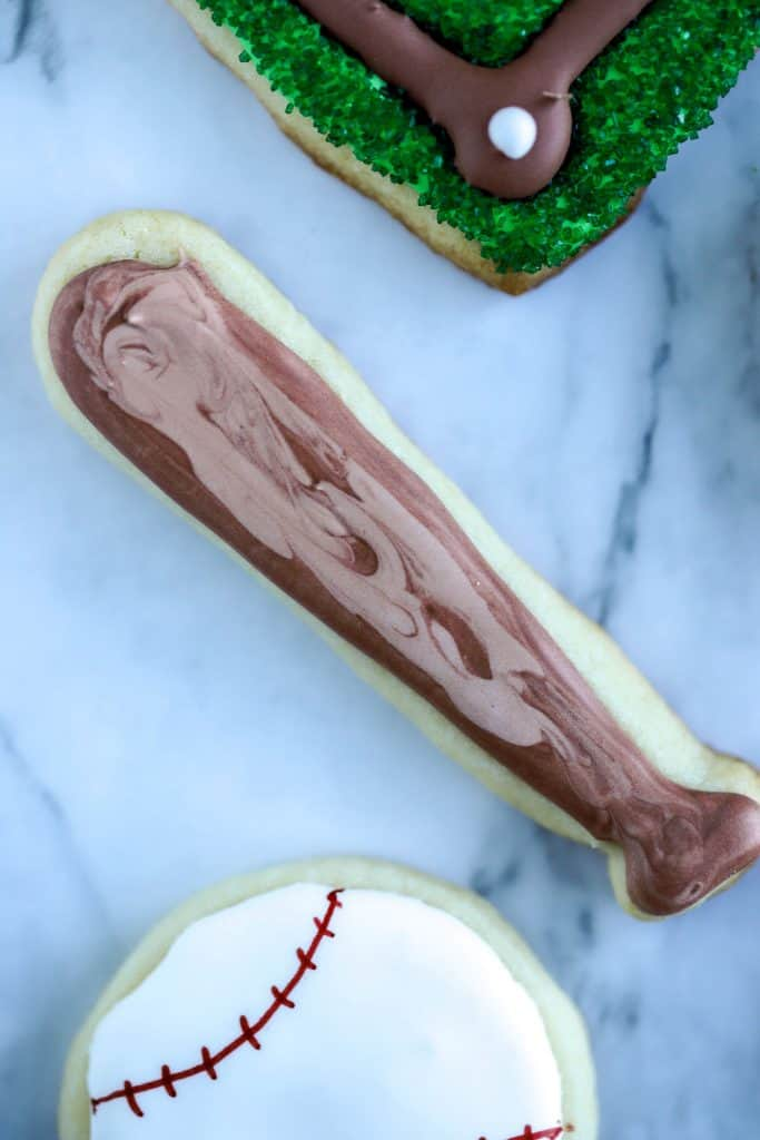 Baseball bat cookie is a sugar cookie decorated with two colors of brown royal icing