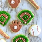 Assortment of baseball cookies including gloves, balls, bats and baseball diamonds