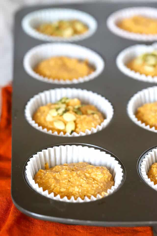 Filled muffin tin with batter for healthy pumpkin muffins before baking