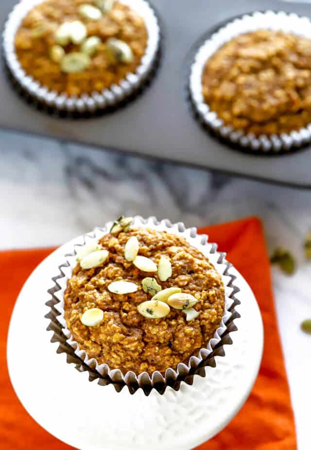 Overhead photo of healthy pumpkin muffins topped with pumpkin seeds