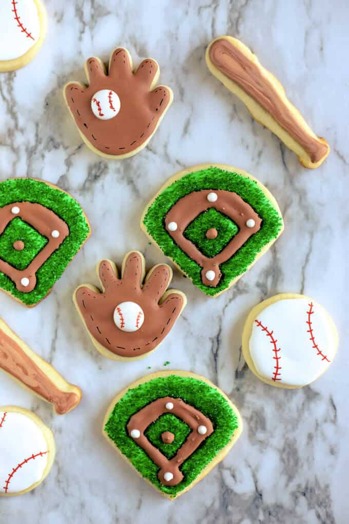 Variety of baseball cookies-- gloves, ballparks, baseballs and bats