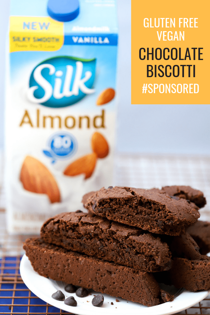 This recipe for Chocolate Biscotti is perfect for game night, family dinners, celebrations, and festive gatherings. Made with plant-based ingredients like AlmondMilk from Silk, this chocolate biscotti is vegan and gluten free. #Sponsored #Silk #abakershouse #LoveMySilk #LoveSprouts #PlantBasedTastesGreat #Vegan #VeganDessert #Chocolate #ChocolateDessert #GlutenFree #GlutenFreeDessert #HolidayBaking #Biscotti