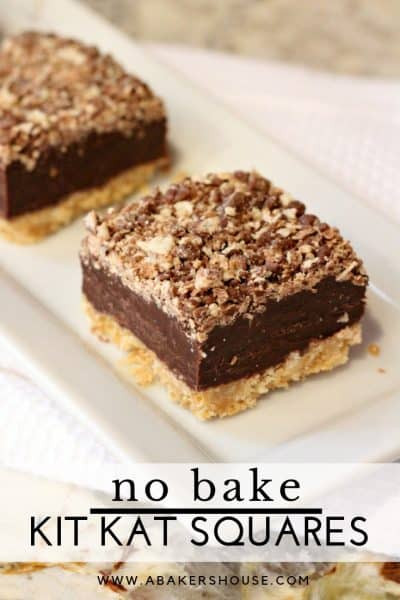 Kit kat square layered no bake dessert on a white plate