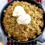 Gluten free baked easy apple crisp with two scoops of vanilla ice cream on top