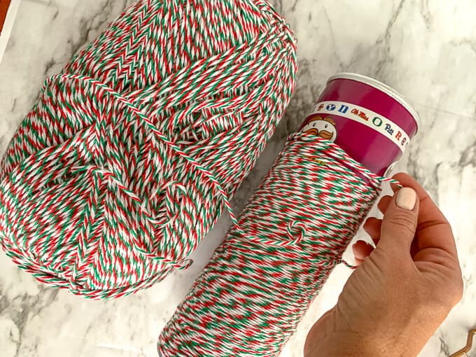 Yarn is wrapped around a Pringles can for an easy decoration and craft