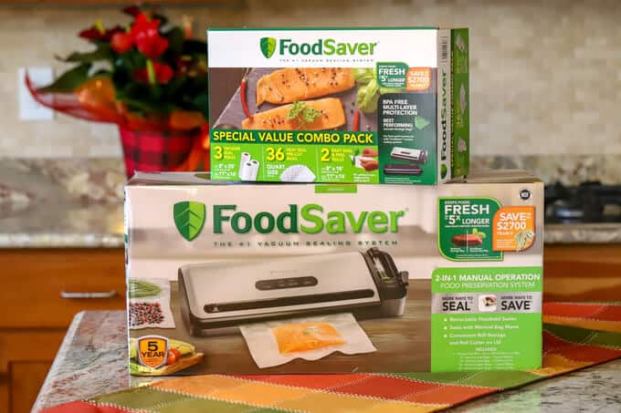 Newell foodsaver products in a stack on the countertop with flower in background